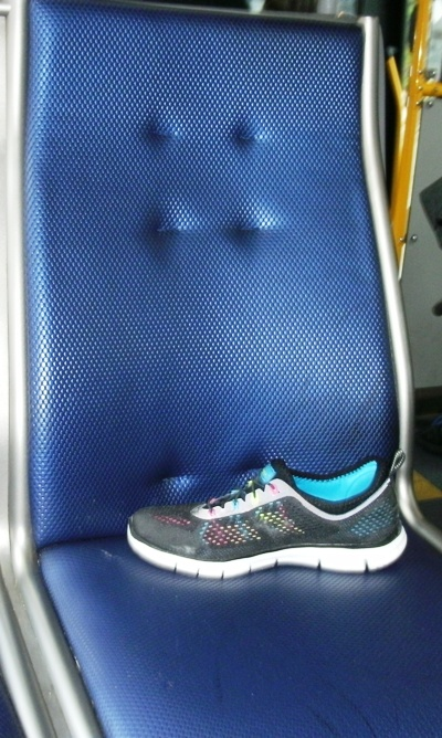Running shoe on bus seat