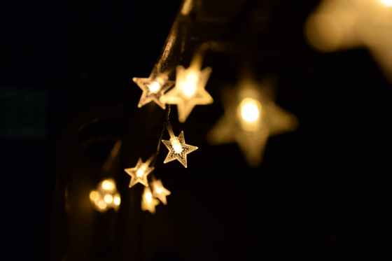 shallow focus photography of yellow star lanterns